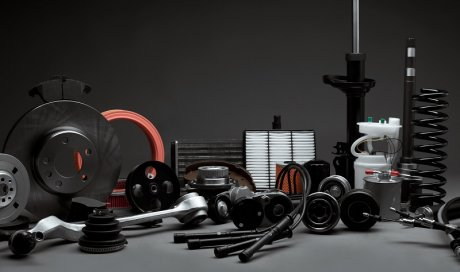 Garage automobile pour faire changer les amortisseurs d'une voiture Charnècles
